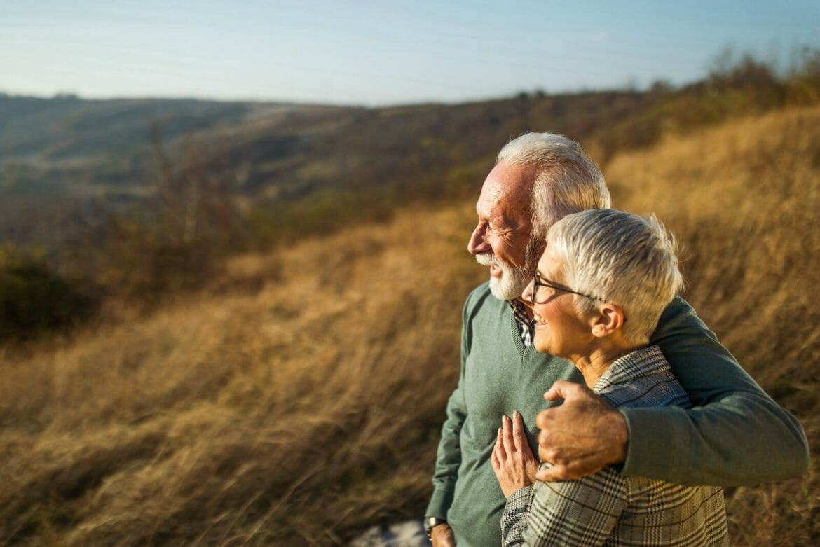 Picture of elderly couple standing outside and enjoying the view